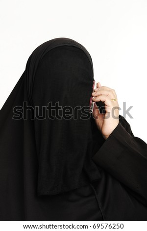 Traditional Arab woman taking phone - stock photo