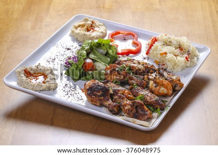 traditional arabian food dish with spicy chicken wings
