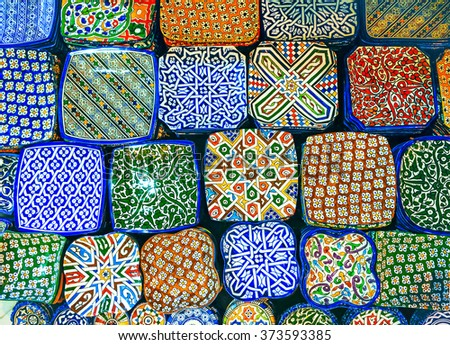 Traditional arabic handcrafted, colorful decorated plates shot a - stock photo
