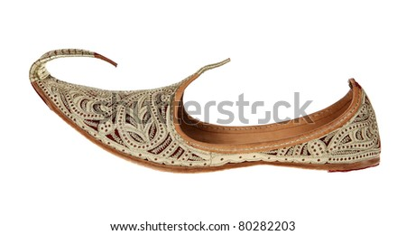 Traditional Arabic shoes over white background - stock photo