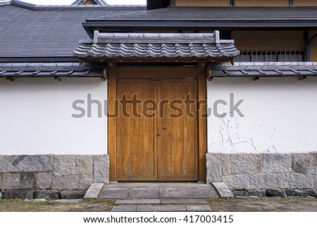 Traditional arched entrance of ancient japanese building - stock photo