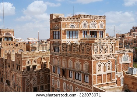 Traditional architecture in Sanaa at sunrise, Yemen. Inhabited for more than 2.500 years at an altitude of 2.200 m, the Old City of Sanaa is a UNESCO World Heritage City - stock photo