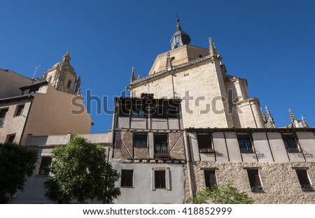 Traditional architecture in the historic centre of Segovia, Spain, with the Cathedral in the background - stock photo