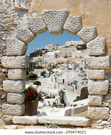 Traditional architecture of Oia village on Santorini island, Greece - stock photo