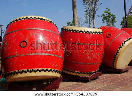 Traditional arge Chinese drums with brass handles and black tacks
