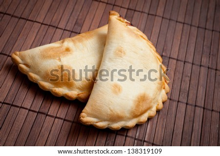 traditional Argentinian empanadas, or meat pie. - stock photo