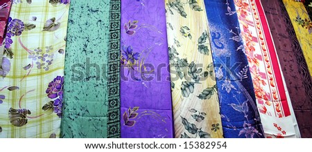 Traditional asian fabrics and clothes for sale in a shop in Malaysia - stock photo