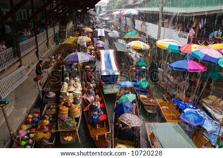 Traditional Asian floating market near Bangkok, Thailand. - stock photo