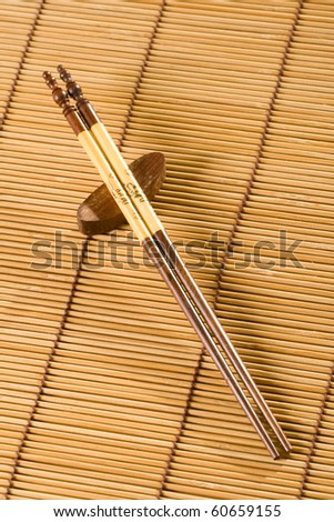 Traditional asian hand made chopsticks on table cover.