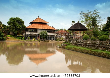 traditional asian landscape with  houses, blue sky and yellow river(Bali, Indonesia)