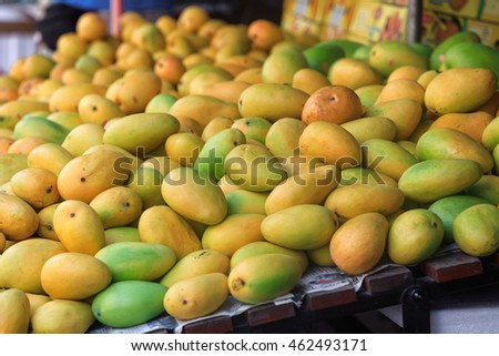Traditional asian market stall full of fresh mangoes