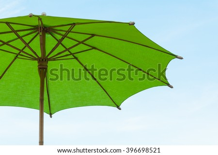 Traditional Asian paper and bamoo umbrella with a rounded handle on bluesky - stock photo