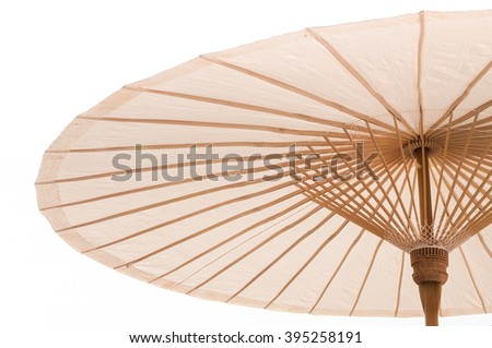 Traditional Asian paper and bamoo umbrella with a rounded handle on white background - stock photo