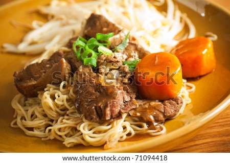 Traditional Asian plate noodle with beef - stock photo