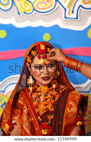 Traditional Asian Wedding. Lots of color and excitment - stock photo