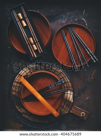 Traditional asian wood sticks with the rice bowl on the rustic background - stock photo