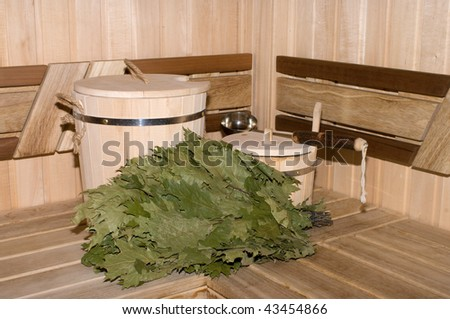 Traditional attributes of Russian bath in a sweating room interior. - stock photo