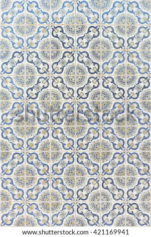 Traditional azulejos tiles on facade of old house, Algarve, Portugal - stock photo
