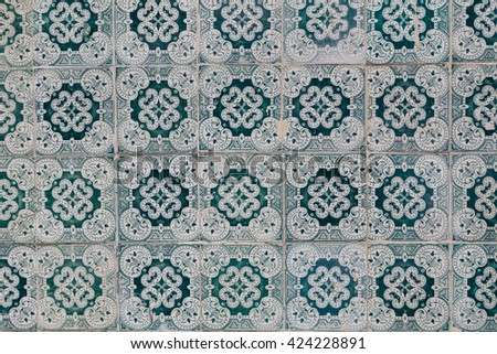 traditional azulejos tiles on facade of old house in Portugal - stock photo