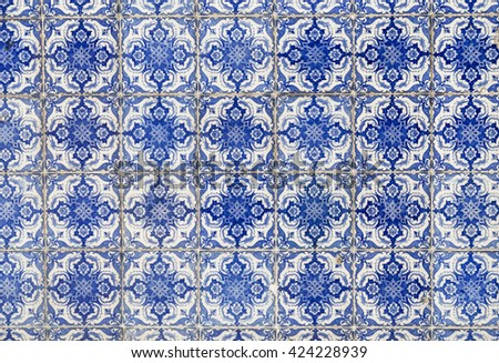 traditional azulejos tiles on facade of old house in Portugal