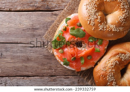 Traditional bagel with salmon and cream cheese on the table. horizontal view from above  - stock photo