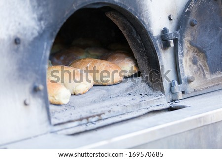 Traditional baking bread in a wood oven