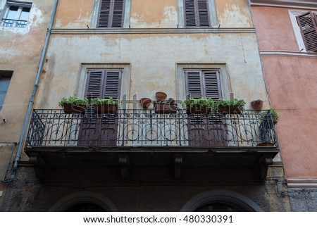 traditional balcony in historical center in Italy