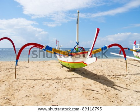 "Traditional balinese ""dragonfly"" boat on the beach"