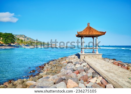 Traditional Balinese gazebo with ocean view. Candidasa, East Bali - stock photo