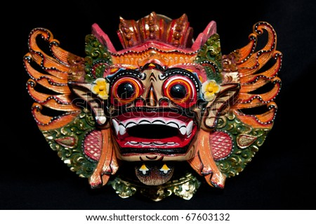 Traditional Balinese mask on a black background. - stock photo