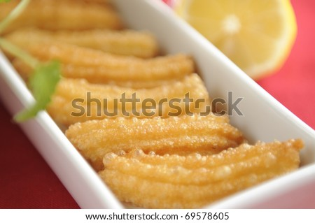 Traditional balkan dessert made of deep-fried uleavened dough poured with syrup - stock photo