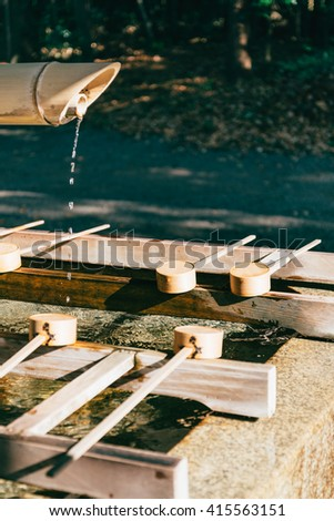 Traditional Bamboo Fountain in Japan, Toned Image, selective focus at bamboo water scoop - stock photo