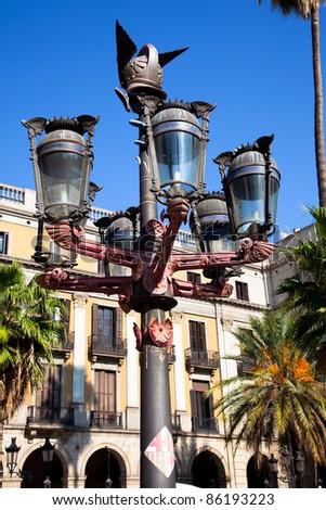 Traditional Barcelona street light at Plaza Real, Barcelona, Spain - stock photo