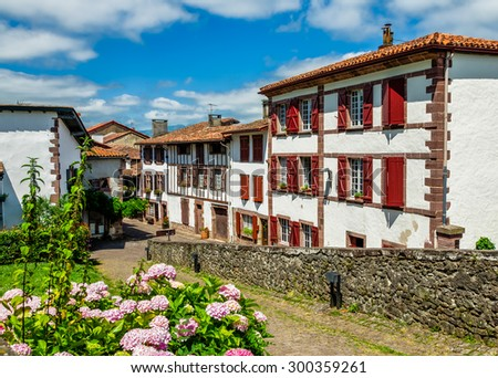 Traditional Basque houses in Saint-Jean-Pied-de-Port - stock photo