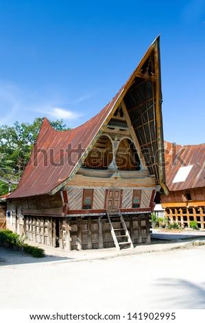 Traditional Batak house on the Samosir island. Indonesia, North Sumatra, - stock photo