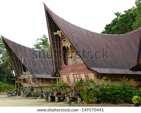 Traditional Batak house on the Samosir island. Indonesia, North Sumatra - stock photo