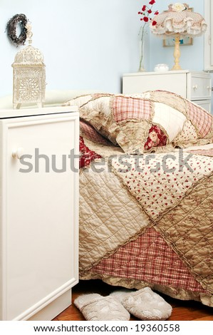 Traditional bedroom with floral bedding - stock photo