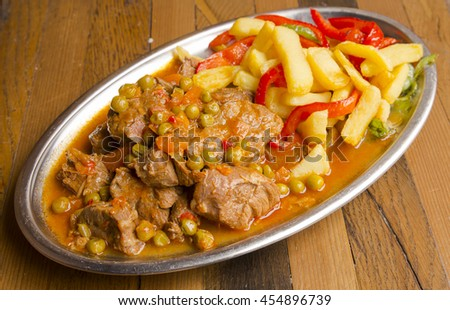 Traditional beef stew with fries and sauce - stock photo