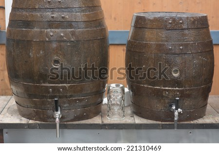 Traditional Beer Barrels with Glass at the Oktoberfest in Munich - stock photo