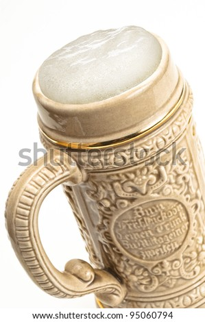 Traditional beer mug with froth, isolated