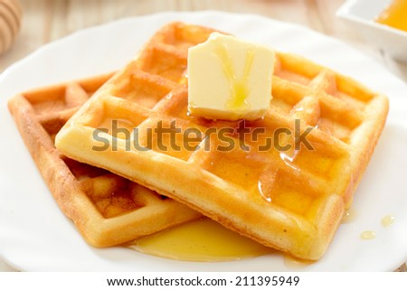 Traditional Belgian waffles with honey and butter - stock photo