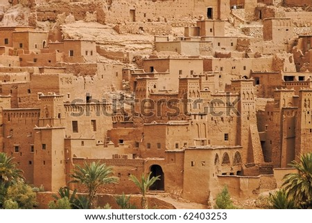 Traditional berber clay ksar kasbah Ait Ben Haddou in Sahara desert, Morocco. This place is famous for being used as film set for many Hollywood movies. - stock photo