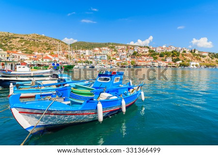 Traditional blue and white colour Greek fishing boat in Pythagorion port, Samos island, Greece - stock photo