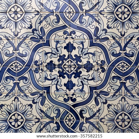 Traditional blue coloured tiles decorating the facades of many old buildings in Lisbon, Portugal.
