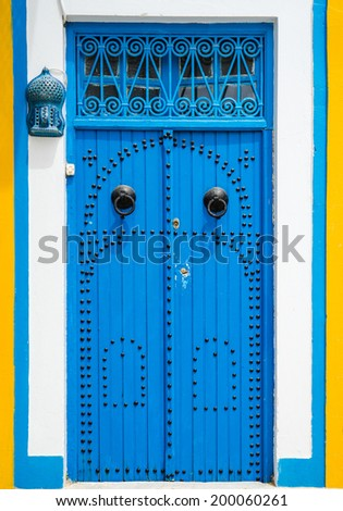 Traditional Blue door with ornament from Sidi Bou Said in Tunisia - stock photo