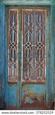 Traditional blue Greek door  - stock photo