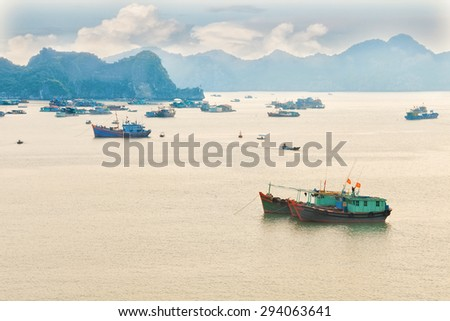 Traditional blue wooden fishing boats in the ocean, Vietnam, Asia - stock photo