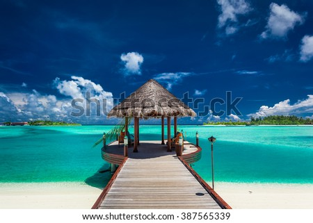Traditional boat jetty in a luxury resort of Maldives, Indian Ocean