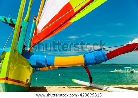Traditional boat natives people tropical islands, called bangka / Sailing wooden boat on the Tropical beach / Indonesia, Bali - stock photo