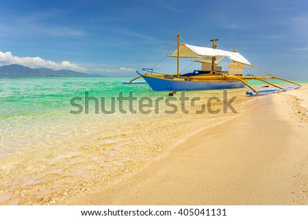 Traditional boat on Modessa island, near Palawan, Philippines